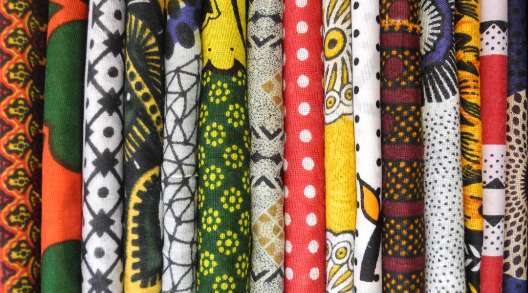 The picture shows folded East African cotton fabrics used mainly for women's clothing, Foto: Berenike Eichhorn.